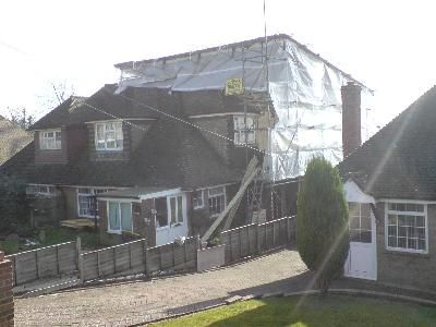 Loft Conversion Scaffold enclosed the roof Heathfield,East Sussex