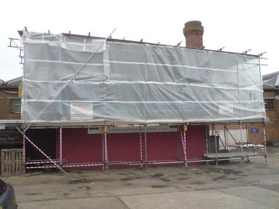 scaffolding roof sheets were carefully dressed around the chimney stack to prevent any leaks. Great Scaffolding chaps!!